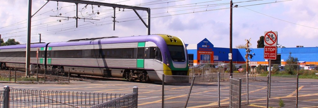V/Line train going through level crossing. Photo: RailGallery.com.au